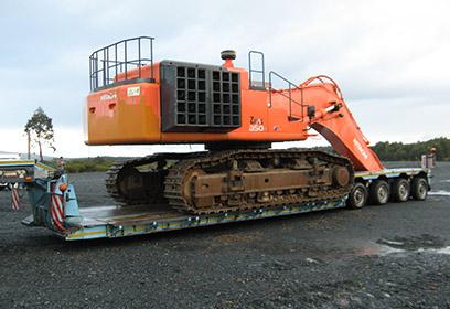 Transporte excavadora obra publica